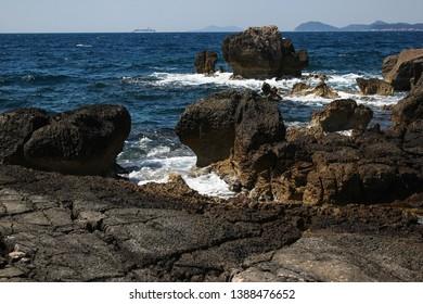 Lokrum main beach detailed shot with waves smashing on the rocks, Dubrovnik, Croatia.