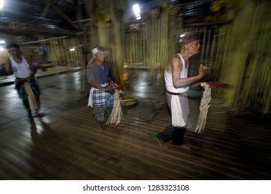 Loksado - Sept. 28: The Dayak Meratus man dances around the offering located in the middle of the room during the traditional rice harvest ceremony on September 28.2014 at the Dayak traditional house