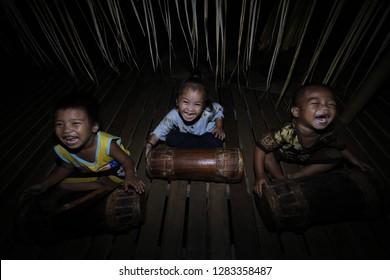 Loksado - Sept. 28: Meratus Dayak children play traditional drums on traditional rice harvest ceremonies on September 28.2014 at Dayak traditional house, Malaris village, Loksado, Indonesia