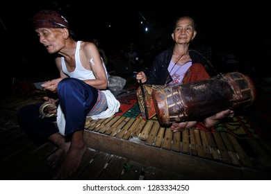 Loksado - Sept. 28: Meratus Dayaks play a traditional drum on a traditional rice harvest ceremony on September 28,2014 at the Dayak traditional house, Malaris Village, Loksado, Indonesia