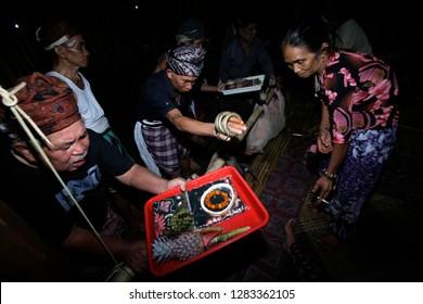 Loksado - Sept. 28: Offering to ancestors at a traditional rice harvest ceremony on September 28.2014 at the Dayak traditional house, Malaris Village, Loksado, Indonesia