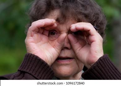 Lokuta/Estonia - 22.07.2012: Portrait of a 70 year old woman goofing around