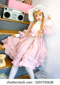 Lolita girl in an old fashion shop, Japanese style