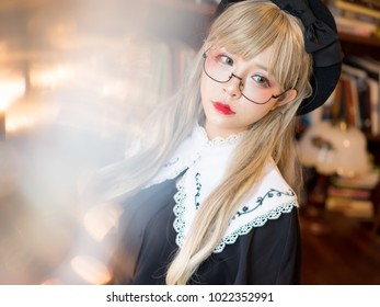 Lolita girl reading in library japanese style