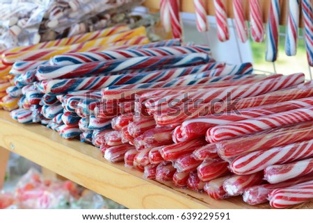 Traditional candy suckers in cellophane strip