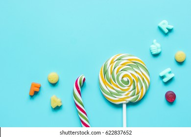 lollipop design with sugar candys on blue background top view mockup