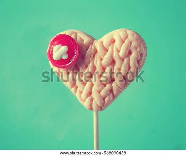 Lollipop heart with knitted texture, love, romantic, valentine`s day concept.