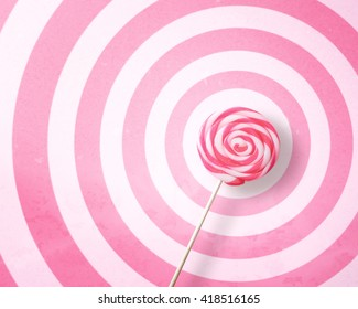 Lollipop on circle pattern pink and white background with copy space.,Pastel tone.
