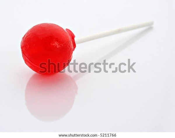 Lollipop on white background with gentle reflection