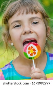 Lollipops in the hands of child. Selective focus.