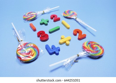 Lollipops with Plastic Numbers