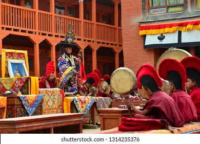 LO-MANTANG, NEPAL - MAY 14, 2018 : Monk in mask performs the religious rite of secrecy of Tibetan Buddhism in front of the monks during the Tiji festival in capital of the kingdom of Mustang, Nepal.