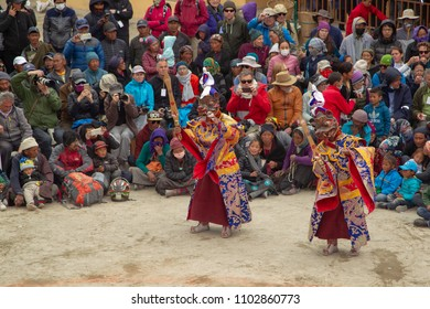 LO-MANTHANG, NEPAL - MAY 13, 2018 : Unidentified tibetan men, dressed in a mystical mask, perform a dance during the Tiji festival in monastery at Lo-Manthang, Nepal.