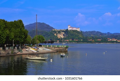 the Lombard side of Lake Maggiore, with the castle of Angera on the top of the hill, taken from Arona