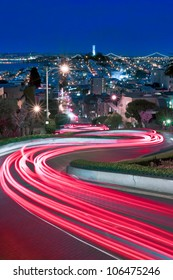 Lombard Street, one of the more famous of San Francisco, California is spiced up by some late night tourists and a long exposure.