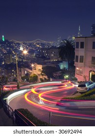 Lombard Street in San Francisco with Coit Tower, Bay Bridge and Transamerica Pyramid in the Background
