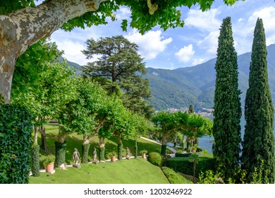 LOMBARDY, ITALY - AUGUST 02, 2018: Villa Balbianello yard with green trees and ornaments