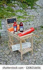 Lombardy,Italy-September,18.2018 - Bottles of Campari, an alcoholic liqueur containing herbs and fruit (including chinotto and cascarilla), invented in 1860 by Gaspare Campari in Novara, Italy