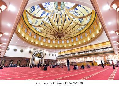 LOMBOK - INDONESIA / 06.24.2018: People praying interior of Lombok Islamic Center, Mataram, Lombok, Indonesia
