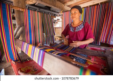 LOMBOK, INDONESIA : 4 JUNE 2015 - Sasak old woman traditionally makes yarn with a spindle wheel at traditional Sasak village, Desa Sasak Sade, Lombok Indonesia.