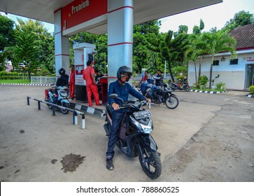 Lombok, Indonesia - Apr 16, 2016. People at petrol station in Lombok, Indonesia. Lombok is an Indonesian island east of Bali and west of Sumbawa.