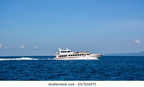 Lombok, Indonesia - Apr 19, 2016. A ferry running on sea in Lombok Island, Indonesia. Lombok is famous for its largely deserted, white sand beaches.