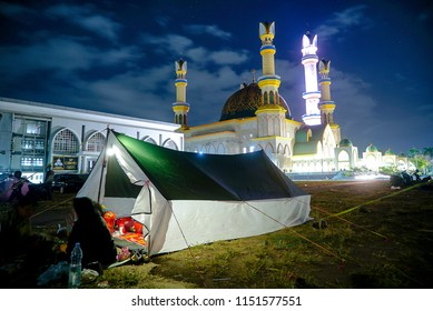 LOMBOK INDONESIA AUGUTS 8 2018 : People set up tents in the field from the Lombok earthquake in Mataram City