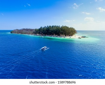 LOMBOK INDONESIA, December 16 2019 : Tropical Island. View of nice tropical empty sandy beach with boats, turquoise water in Gili Nanggu Lombok Indonesia