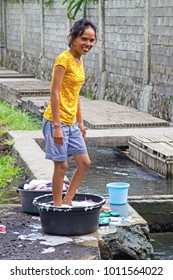 LOMBOK, INDONESIA - DECEMBER 30, 2016: Washing clothes in an old fashioned way in Lombok, Indonesia on 30th december 2016
