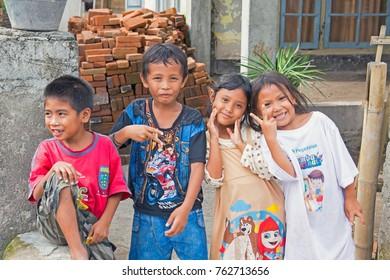 LOMBOK, INDONESIA - DECEMBER 30, 2016: Indonesian kids in the streets in Lombok, Indonesia on the 30th of december 2016