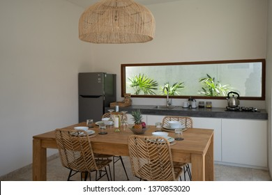 LOMBOK, INDONESIA - February  11 2019: A beautiful private dining area in the Kumbara villa in Kuta on the island of Lombok showing some wine bottles and a kitchen