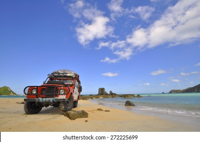 LOMBOK, INDONESIA - JUNE 24: An unnamed driver completes a beach section during the MROC off roading trials event at Lombok Beach on June 24, 2012 in Indonesia