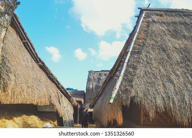 LOMBOK, INDONESIA - June 27, 2015: A visitor exploring traditional Sade Village in Lombok where more than 300 families of Sasak ethnicity live and carry on their culture reaching third generation now.