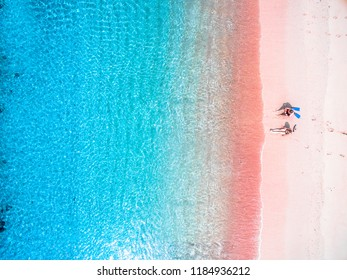 LOMBOK INDONESIA, September 22 2018 : Couple tourist enjoy the Pink Beach Indonesia