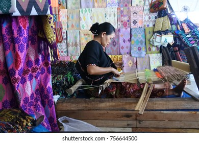 Lombok, Indonesia, september 28, 2017 - A woman is weaving a cloth traditionally in a remote area of Lombok Indonesia