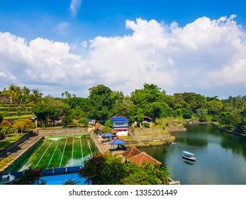 Lombok island, Indonesia - January 11, 2019: Graet architecture at Pura Mayura in mataram lombok, ethnic Hindu water temple in Lombok island, Indonesia.