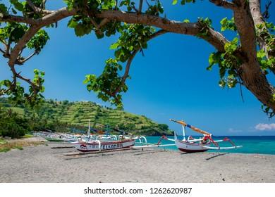 Lombok, West Nusa Tenggara / Indonesia - October 29, 2011 : A view of traditional boat in Senggigi Beach, Lombok.