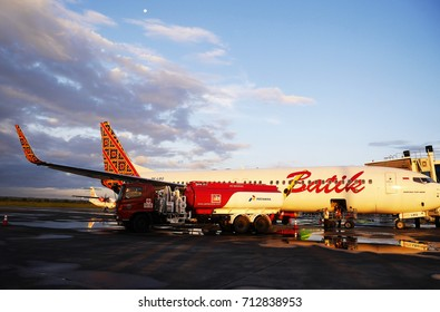 LOMBOK/INDONESIA - APRIL 30, 2015: A plane refueling at the airport in the morning light