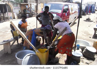 "LOME,  TOGO - CIRCA NOVEMBER 2010 : Women making Togolese traditional food ""FUFU"" at the street in LOME."
