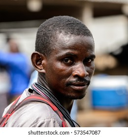LOME, TOGO - Jan 9, 2017: Unidentified Togolese man with mustache at the Lome port. Togo people suffer of poverty due to the bad economy
