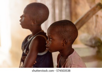 LOME, TOGO - Jan 9, 2017: Unidentified Togolese attentive young boys in the local shaman's house. Togo children suffer of poverty due to the bad economy