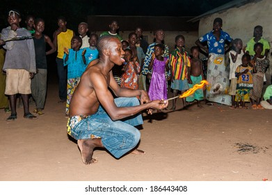 LOME, TOGO - MAR 7, 2012: unidentified Togolese man show tricks with the fire show performance. People in Togo suffer of poverty due to a difficult economical situation