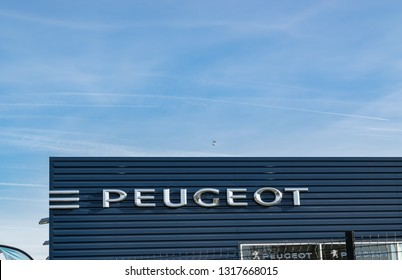 Lomme,FRANCE-February17,2019:Peugeot logo on the car dealership building.Peugeot is a French company producing cars.The company was founded in 1810.The company together with citroën form the PSA group