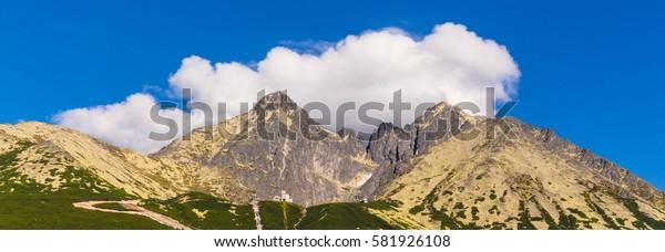 Lomnicky peak on cloud background. Slovak Tatra mountains. Mountain scenery.