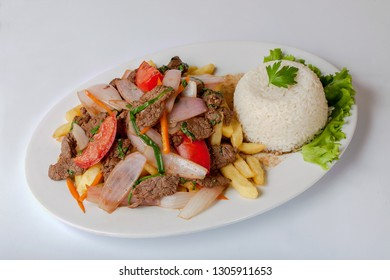 Lomo Saltado, beef, French fries with onions. PERUVIAN FOOD