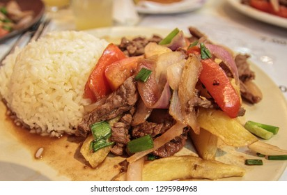 Lomo saltado, a famous dish of Peru, containing beef, onions, tomatoes and soy sauce. Usually eaten with rice and chips.