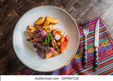 Lomo saltado traditional peruvian plate close up