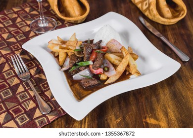 Lomo saltado with white rice and french fries