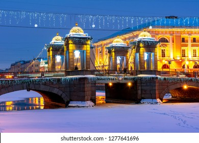 Lomonosov bridge over Fontanka river at night during New Year and Christmas holidays, St. Peterburg, Russia