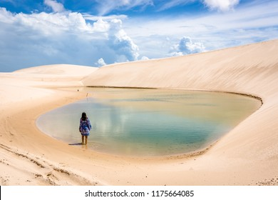 Lonaly woman at amazing landscape of Lencois Maranhenses at north of Brazil